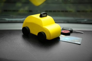 Yellow toy taxi