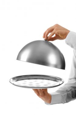 Male waiter holding cloche and tray