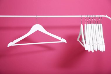 Modern hangers on pink background