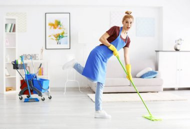 woman moping floor in living room