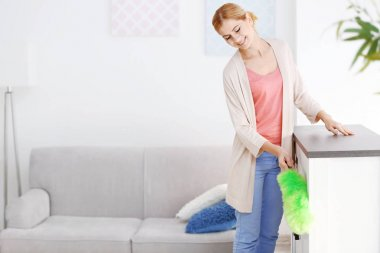 woman cleaning house from dust