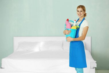 adult woman with cleaning supplies