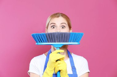 Funny adult woman with floor brush