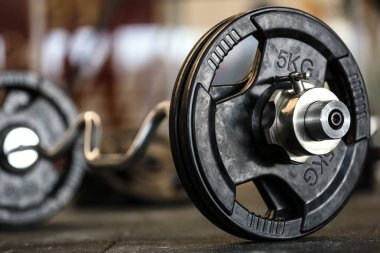 view of barbell on floor in gym