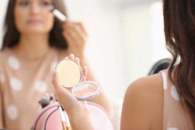 girl applying cosmetics