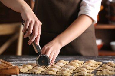 Woman making ravioli