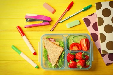 Lunch box with food and stationery