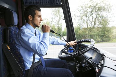 driver using microphone in bus