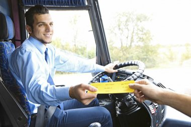 Bus driver taking ticket