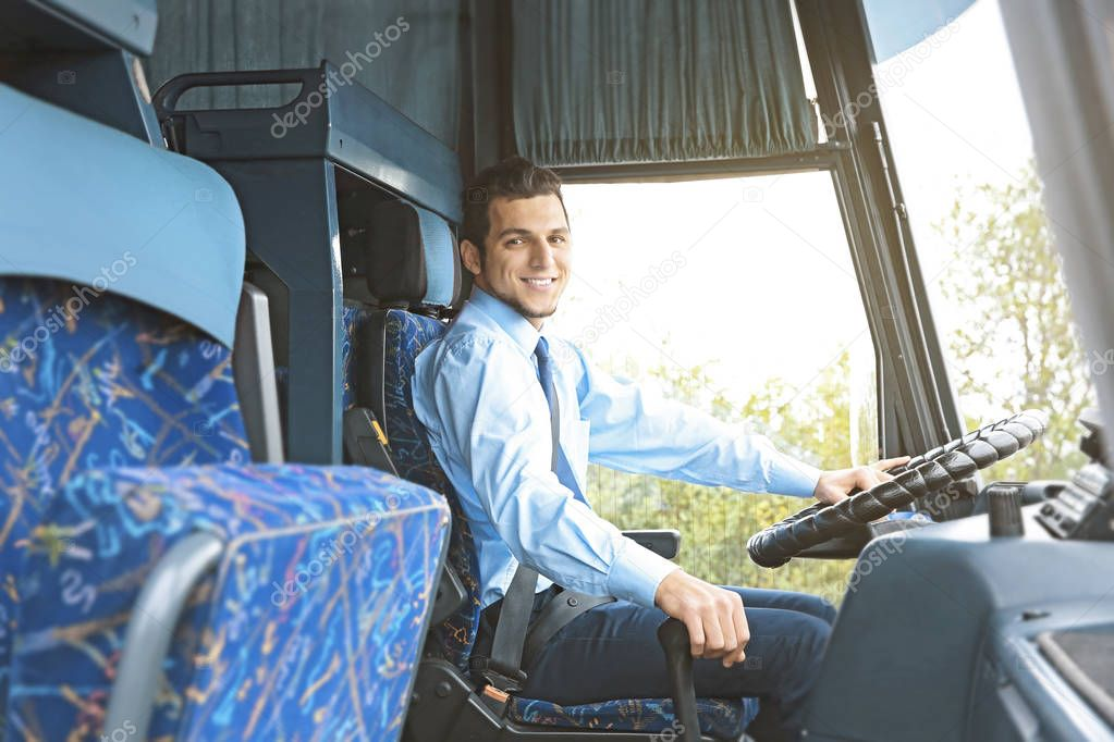 Handsome driver in bus