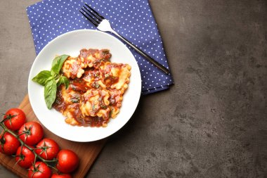 Plate of ravioli with tomato sauce