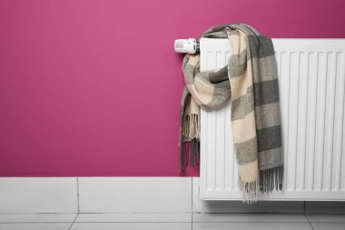 Warm scarf drying on heating radiator