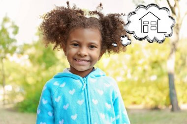 Cute little girl dreaming of home. Adoption, custody and childcare concept.