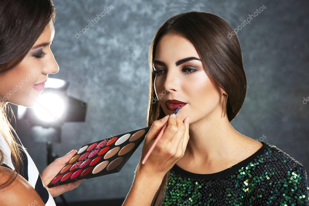 makeup artist and woman