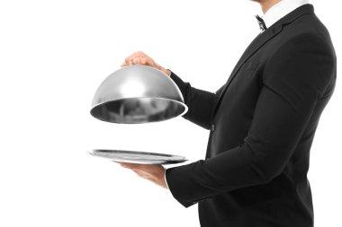 Waiter holding metal tray