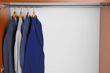 Hangers with male shirts