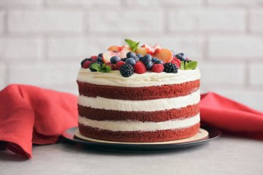 Delicious cake with fruit and berries