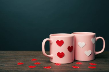 Two cups with hearts