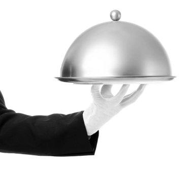 Waiter hand with cloche