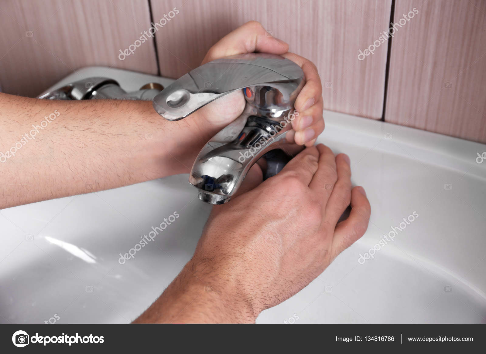 Closeup of plumber fixing tap on sink — Stock Photo © belchonock ...