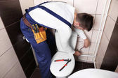 Plumber fixing water hose