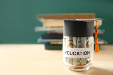 Glass jar with money for education