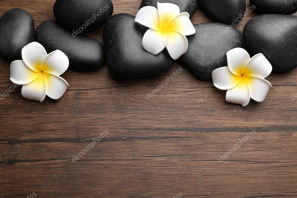 Spa stones and plumeria flowers