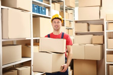 Young man holding boxes