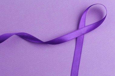 Violet ribbon on color background.