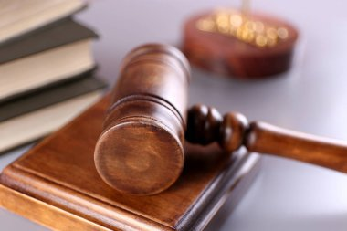 Gavel with books on table