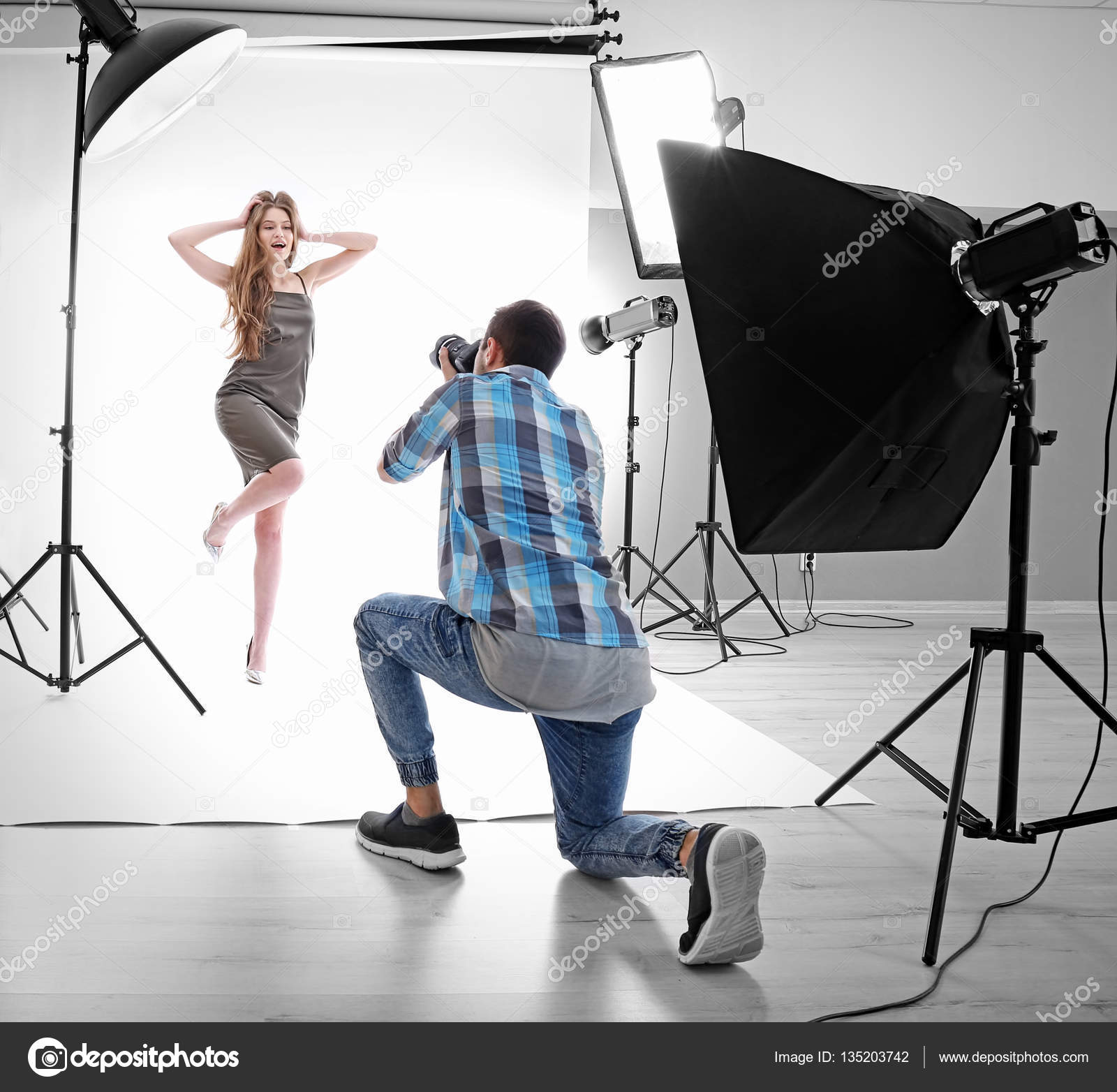 Photographer Taking Picture Of Model In Professional Studio Photo By Belchonock