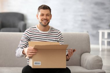 Handsome young man with parcel