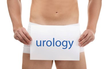 Man holding paper with word UROLOGY