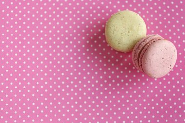 Tasty macaroons on pink