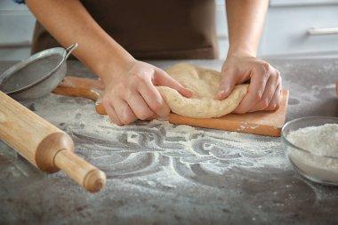 Woman hands kneading dough