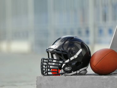 Rugby helmet with ball