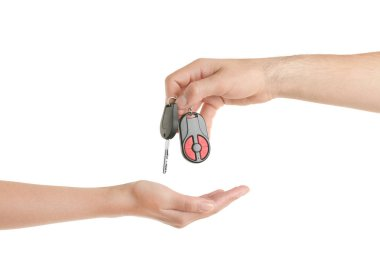 Male hand giving car key