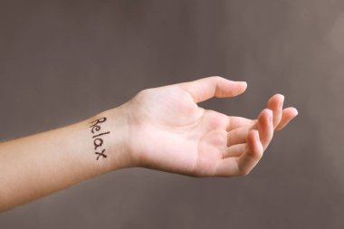 Female hand with tattoo
