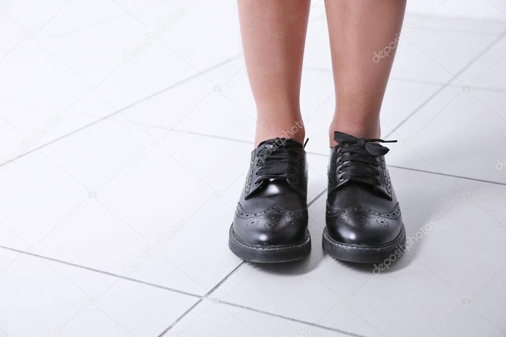 Legs in school shoes
