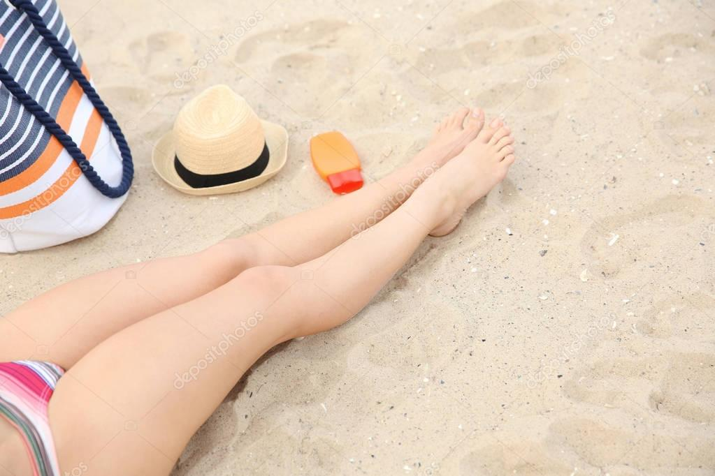 Female legs on the beach