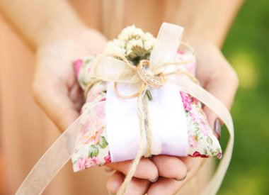 Bridesmaid holding wedding rings