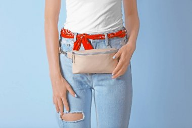 Young woman with beige leather clutch