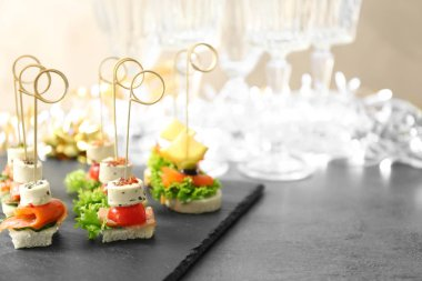 Assorted canapes on table