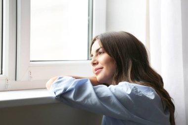 Beautiful woman near window