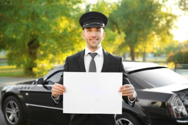 chauffeur standing with white board