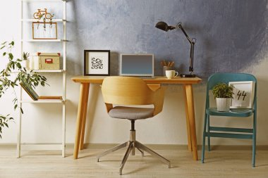 Workplace with laptop on table