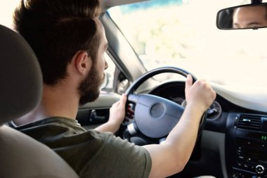 driver keeping hands on wheel