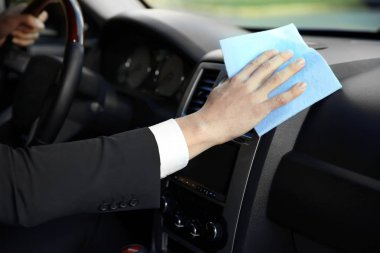 Man cleaning car dashboard, closeup