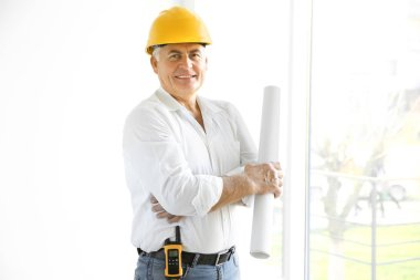 Senior engineer with drawing