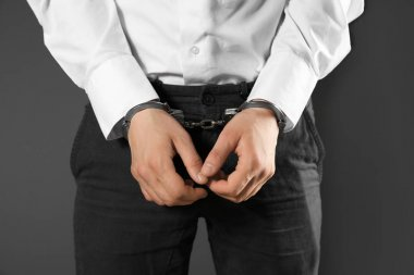 Male hands in handcuffs